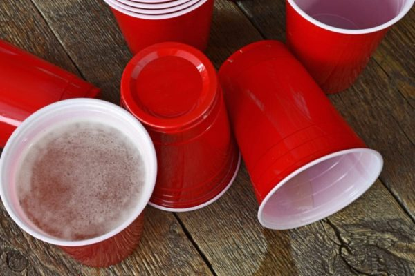 Red solo cups with beer