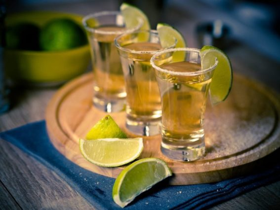 Tequila shots with lime wedges